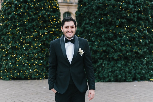 modern groom with black tux