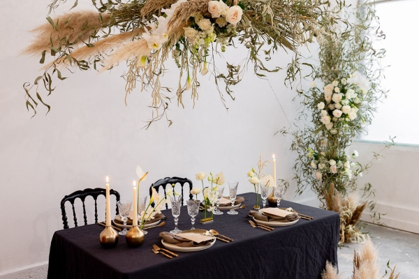 modern wedding table with floral installation