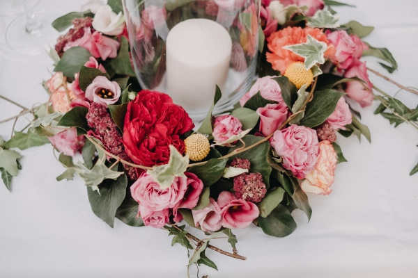 pink florals with white candle