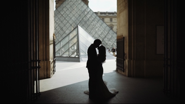 the lourve wedding couple
