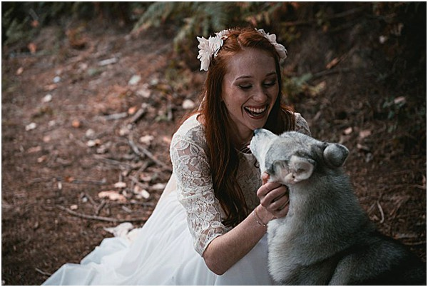 Bride smiling with an Alps dog