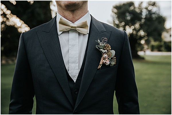 Grooms attracts with buttonhole