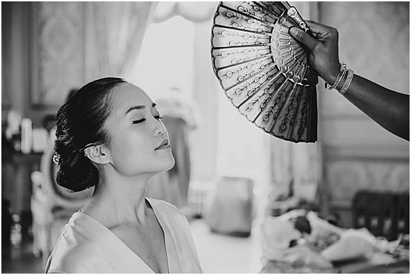 Asian bride being fanned