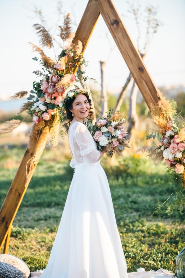 bohemian bride wooden arch