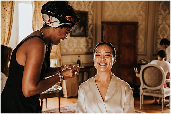 bridle smiling while having her make up done