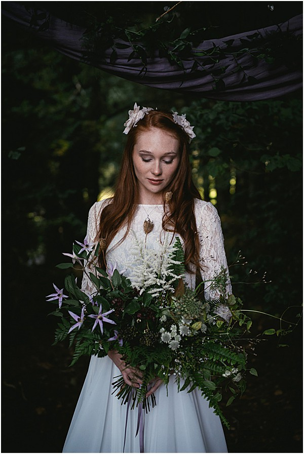 bride with wild floral arrangement