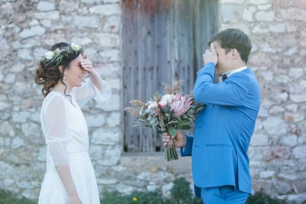 couple hiding their eyes