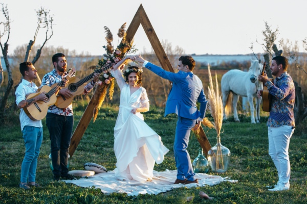 dancing bride and groom boho