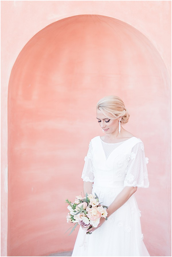 french bride with beautiful pink villa backdrop