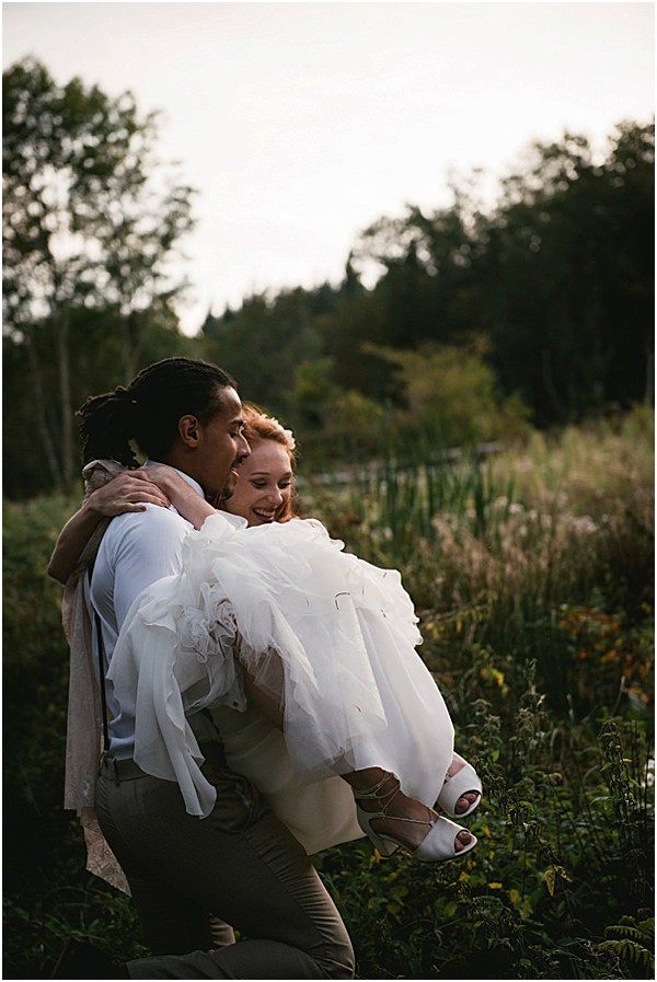 groom carrying bride to forever together