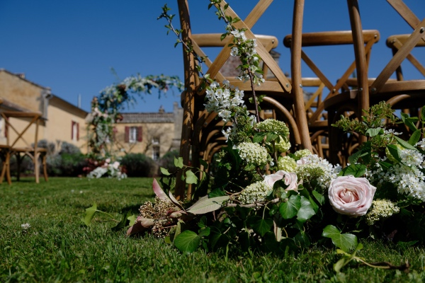 outdoor rustic ceremony florals