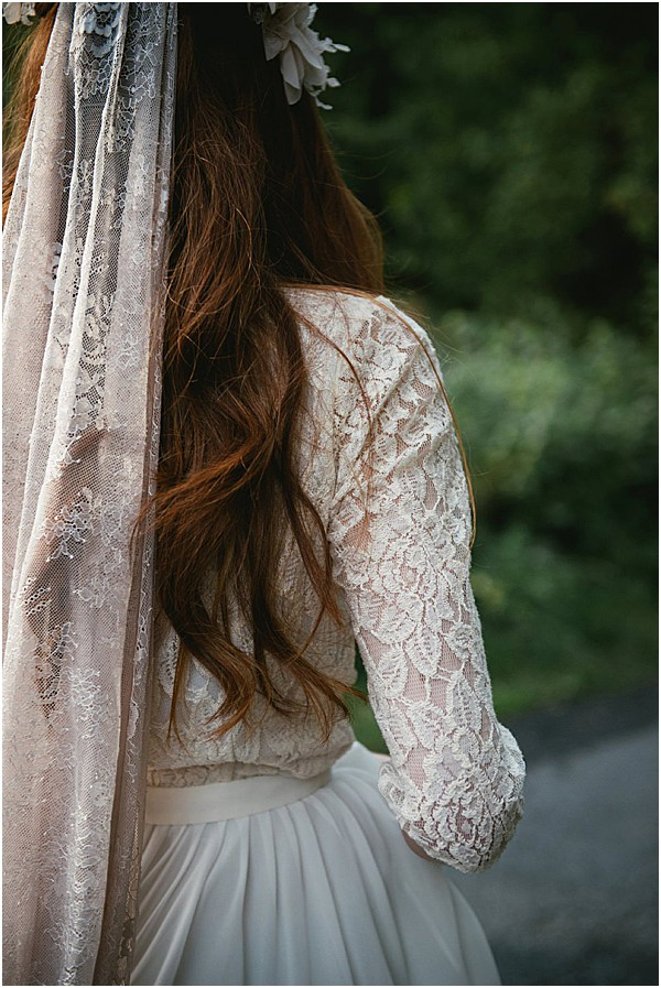 red head in lace wedding gown