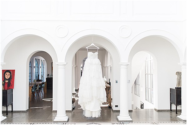 wedding gown hanging in a beautiful villa