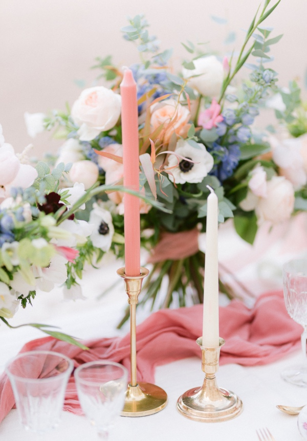 white and pink table candles