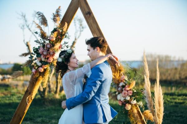 wooden bohemian wedding arch