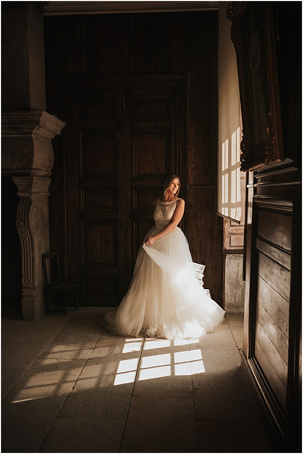The bride is wearing a delicately sensual Rosa Clara dress