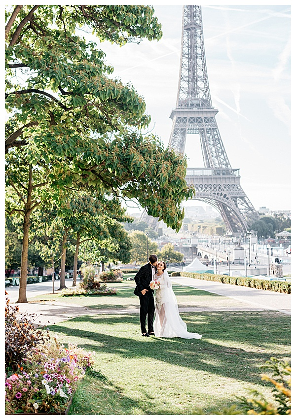 Eiffel Tower in France with couple in love