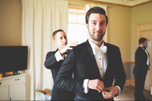 black and white groom suit