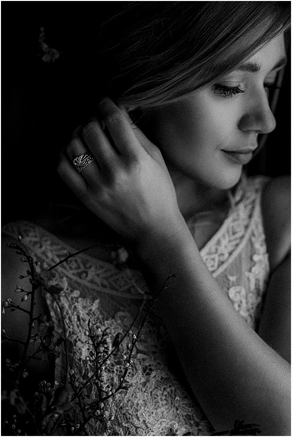 bride in black and white with details rings