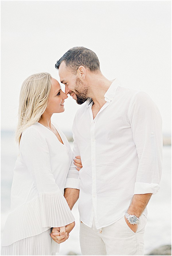 couple in all white in love