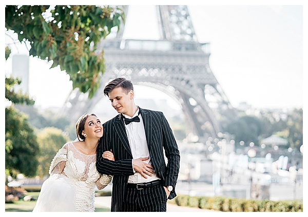 couple in love in front of eiffel tower in france