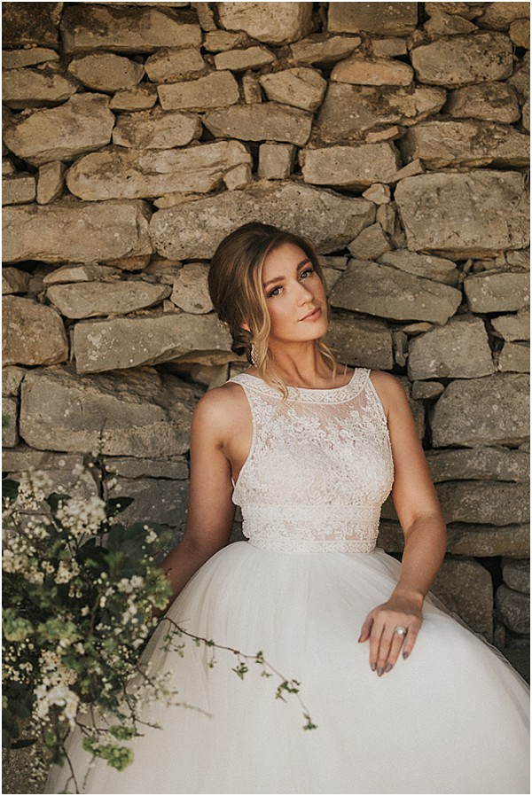 flawless bride with cobblestone walls