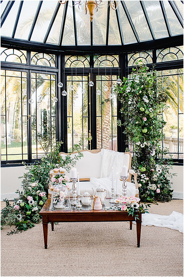 greenery and white flowers with tea party decor