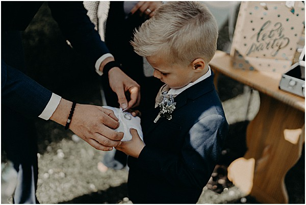 grooms kid with ring pillow