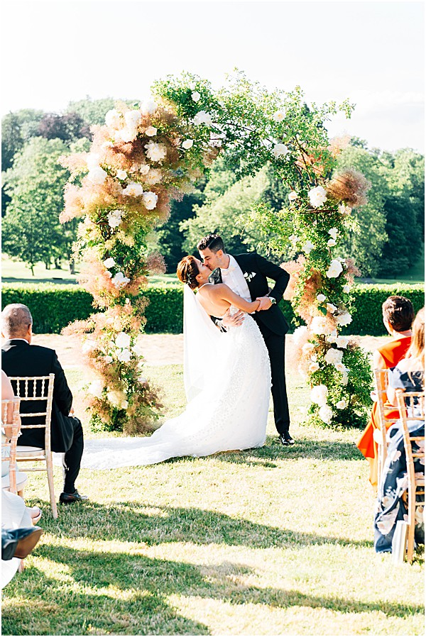 kissing in the foral archway