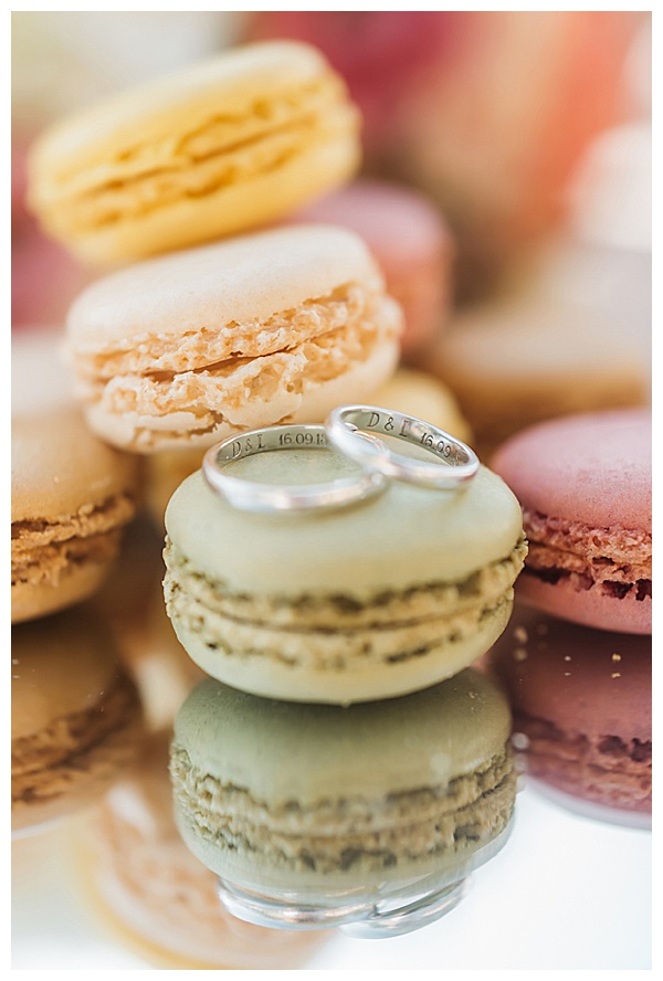 pastel sweets and engraved wedding rings