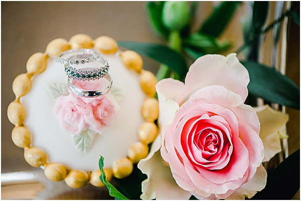 pink rose and sweets with rings