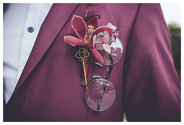 plum suit close up ring glasses fluer