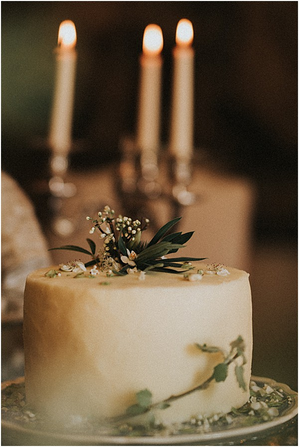 simple wedding cake with florals and candles