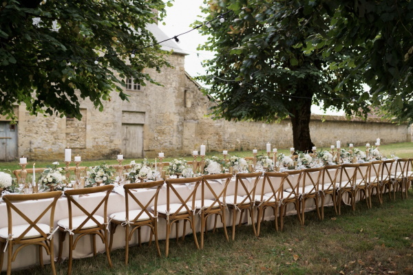 Lilac and gold themed bridal table set up in the gardens of Chateau de Courtomer