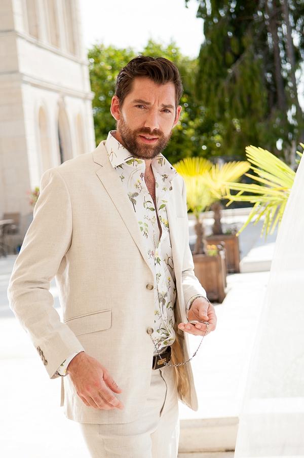 cream grooms suit