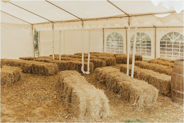 hay bales for wedding seating in France by Matthias Toth Photography