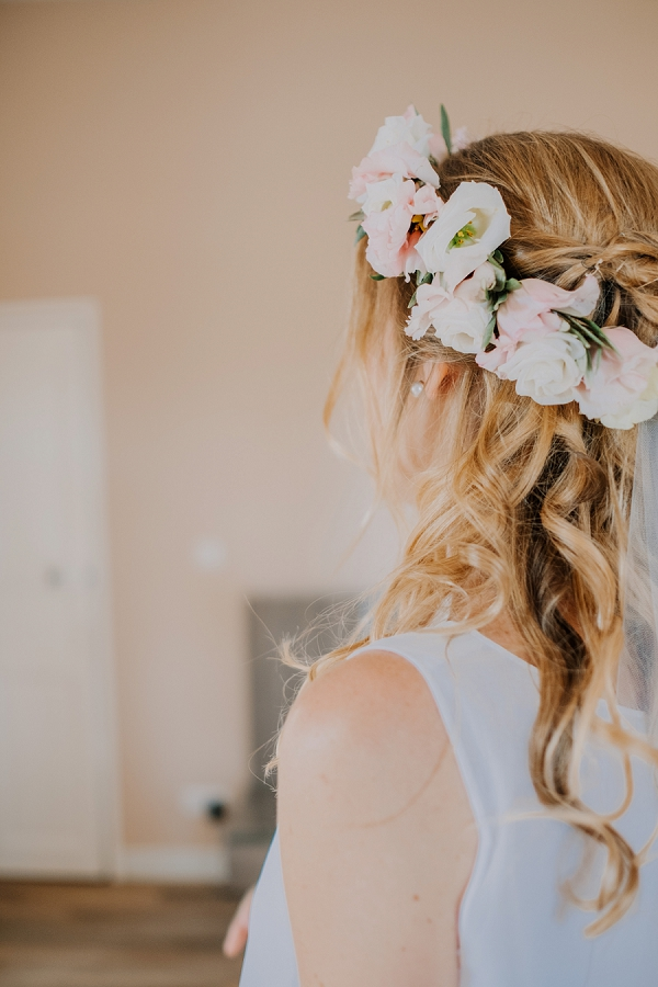 loose curl updo with flower crown