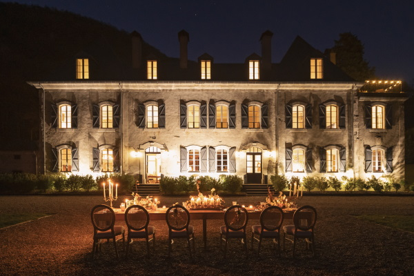 Chateau Siradan at night with wedding table and candles