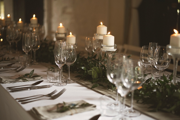 candles and greenery wedding styling