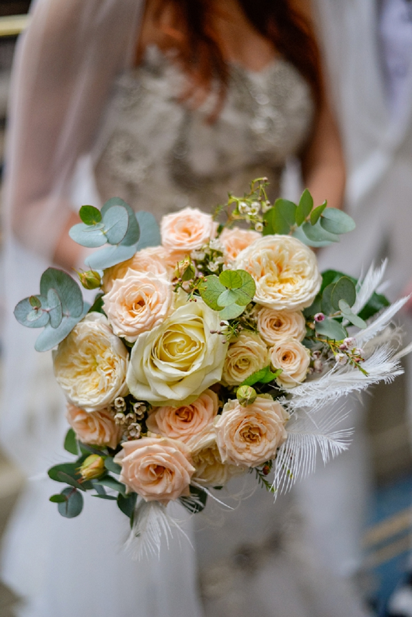 feather and roses bridal bouquet