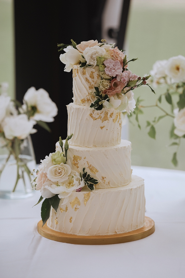 4 tier wedding cake with flowers