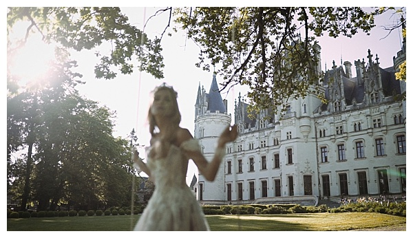 Bride in front of Chateau Challain