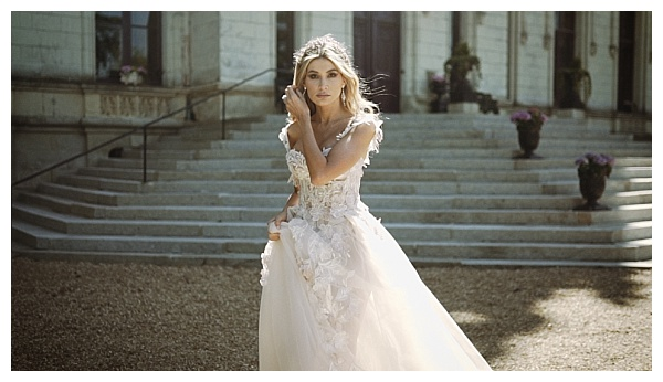 Bride in front of chateau steps