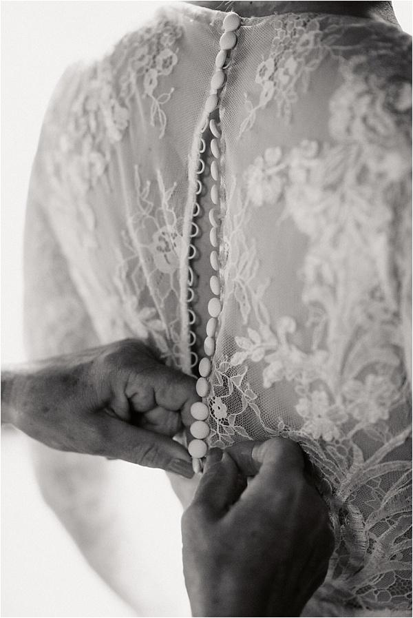 Brides Dress Buttoning Up