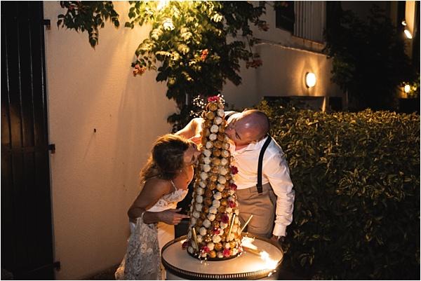 Newlyweds eating profiteroles cake