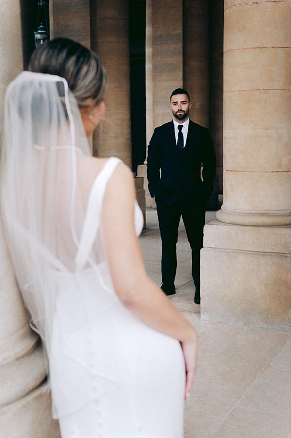 Admiring his bride