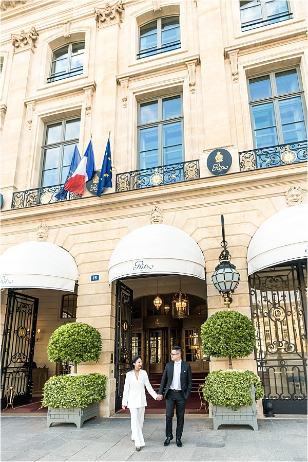 Couple in front of the ritz paris