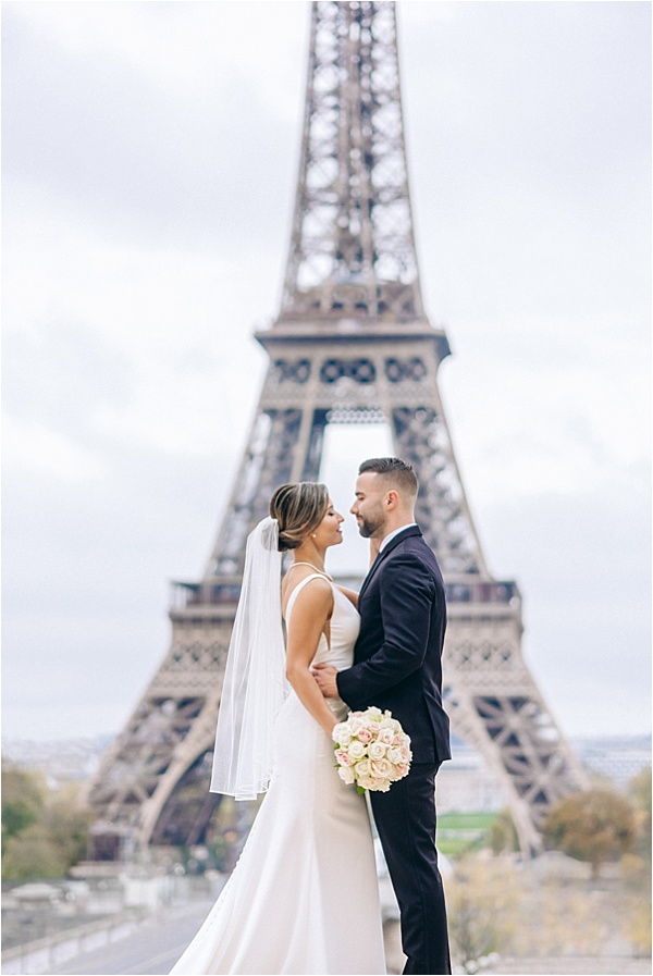 Happy eloped couple at the eiffel tower