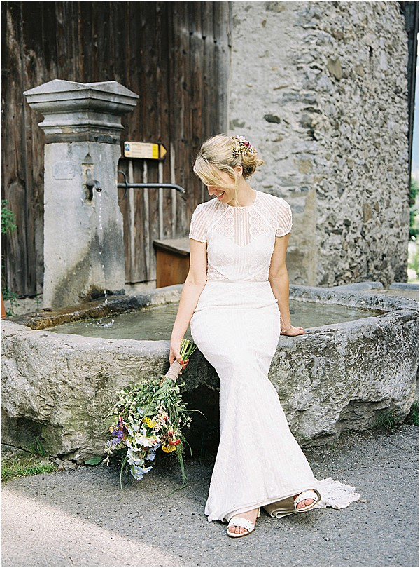 lace fitted bridal dress and fountain Images by Alexander J Collins