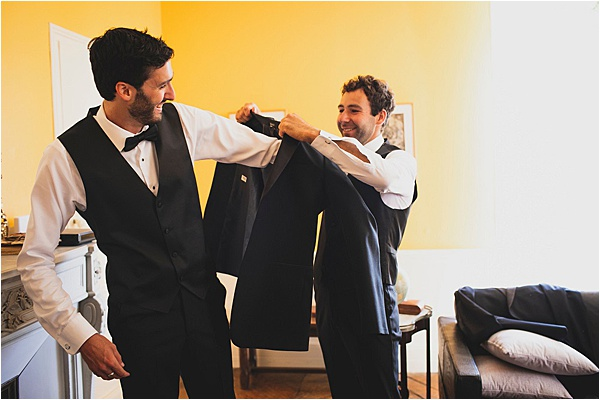 Best man dressing the groom
